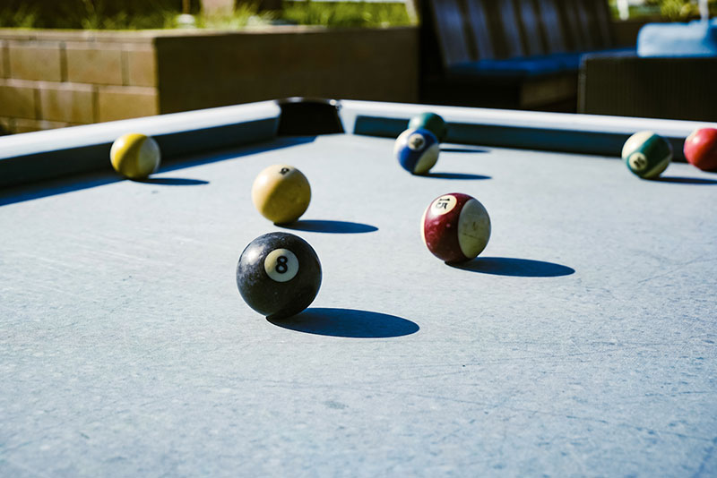 closeup of pool balls on outdoor pool table